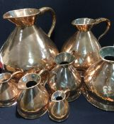 A 19th century matched graduated set of seven copper haystack measures The largest 4 gallons.
