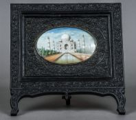 A 19th century Indian miniature on ivory depicting the Taj Mahal Set in a florally carved ebony