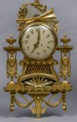 A Louis XVI style carved giltwood cartel clock The circular dial surmounted with a florally wrapped