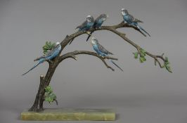 An Austrian cold painted bronze model of budgerigars perched on a branch Mounted on an onyx plinth