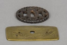 Two Japanese tsuba One decorated with fish and signed Kanemono Ton Kotsu. 10 cm wide.