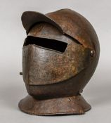 An antique armour helmet Of collared form, with moveable guard and visor. 26 cm high.