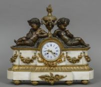 A patinated and gilt bronze mounted marble mantel clock The white enamel dial with Roman numerals