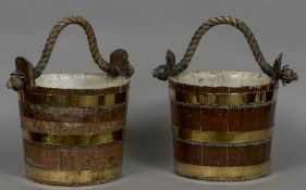 A pair of 19th century ship's buckets Of coopered construction with rope twist handles.