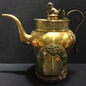 An antique Chinese copper and brass street vendor's tea kettle With dog-of-fo finial,