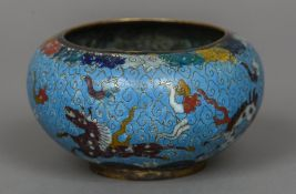 A Chinese cloisonne bowl Decorated with horses, incised two character Ming mark to base. 8 cm high.