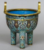 A Chinese cloisonne twin handled Ding censor Decorate with lotus strapwork and an archaic lappet