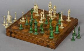 A 19th century ivory chess set Comprising: white and green stained ivory pieces;