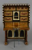 A Syrian parquetry inlaid table cabinet The fall front enclosing a fitted interior,