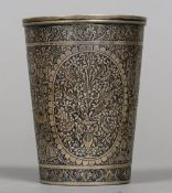 A 19th century Middle Eastern silver beaker Decorated in the round with courtly figures,
