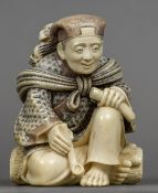 A late 19th/early 20th century Japanese ivory okimono Formed as a gentleman holding pipe with a