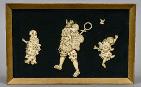 A framed plaque set with three 19th century Japanese carved figures Centred with a gentleman with a