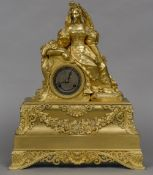 A French Empire ormolu cased mantle clock The silvered dial with Roman numerals and bell striking