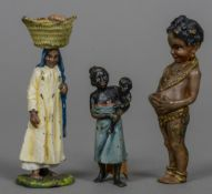 A cold painted bronze model of a Negro child Together with two other small cold painted bronze