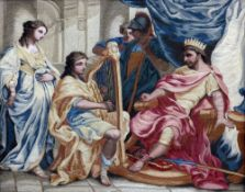 A 19th century silkwork picture Worked with David playing the harp before Saul, framed and glazed.