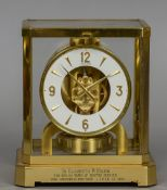 An brass cased LeCoultre Atmos clock Of typical form, the base with a presentation inscription. 23.