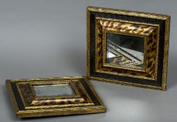 A pair of 19th century cushion moulded mirrors Decorated with faux tortoiseshell designs.
