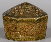 An Antique Kashmiri turban box Of octagonal form, with floral decoration. 17 cm wide.