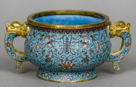 A Chinese cloisonne twin handled Ding censor Allover worked with lotus strapwork,