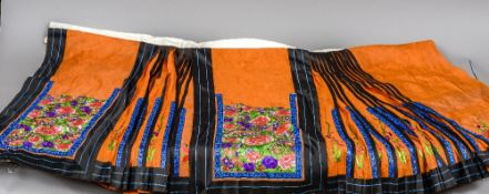 A late 19th/early 20th century Chinese pleated skirt The orange ground with embroidered floral