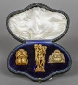 A 19th century Japanese ivory okimono Formed as three entwined fishermen,