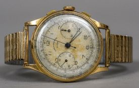 A Swiss gold cased chronograph wristwatch The silvered dial with twin subsidiary dials. 4 cm wide.