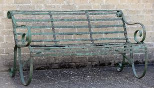 A Regency wrought iron garden bench Of typical form. 154 cm wide.