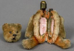 A late 19th/early 20th century miniature plush covered teddy bear form compact Of typical form,