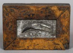 A burrwood framed fossilized Sabretooth tiger tooth 19 cm wide.