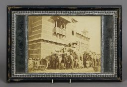 A framed Indian photograph of tourists aboard elephants 42 cm wide.