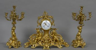 A large 19th century French ormolu clock garniture Of pierced scrolling floral form,