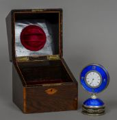A rose diamond set silver mounted enamel desk clock The white enamelled dial bordered by a row of