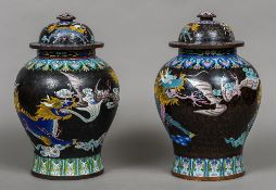 A large pair of late 19th century cloisonne vases Each decorated with bats and mythical beasts,