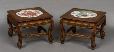 A pair of 19th century Chinese carved wood low tables Each with porcelain panel inset top,