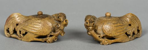 A pair of Chinese carved soapstone wine ewers Each formed as a quail. Each 13.5 cm wide.