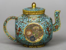 A Chinese cloisonne teapot and cover Of canted spherical form,