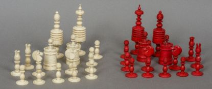 A 19th century carved bone and stained bone chess set The kings 14 cm high.