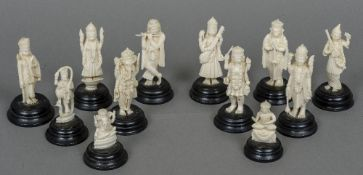 Twelve various late 19th/early 20th century Indian ivory figures Each mounted on an ebonised