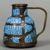 A small enamel decorated Islamic copper vessel 6.5 cm high.