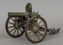 A model Gatling gun Of typical form, with moveable parts and removable ammunition clip. 37 cm long.