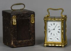 A 19th century lacquered brass cased multi-dial quarter repeating carriage clock The white