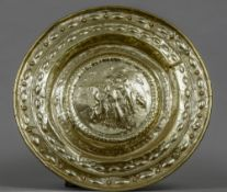 A 17th/18th century brass charger Of typical dished form,