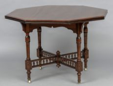 A late Victorian Aesthetic walnut centre table Of octagonal form,