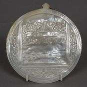 A carved mother-of-pearl shell One side decorated with the Last Supper. 14 cm wide.