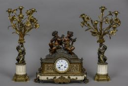A 19th century patinated bronze mounted white marble clock garniture The white enamelled dial with