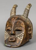 An African wooden tribal mask Probably formed as the devil. 30 cm high.