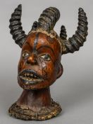 An African tribal mask The multi-horned bust covered with animal hide. 27.5 cm high.