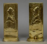 A pair of Arts & Crafts brass wall sconces Each repousse decorated with a bust of a cloaked young