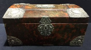 An antique silver plate mounted red stained tortoiseshell casket With hinged panelled domed top.