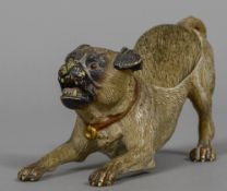 A cold painted bronze pen wipe formed as a pug dog 13 cm wide.